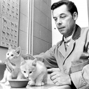 Joseph Clauthier feeds two kittens April 30 1969